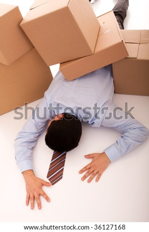 accident with some businessman carrying a pile of cardboard boxes - stock photo