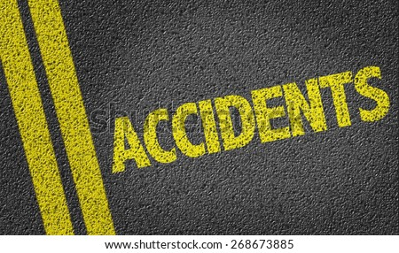 Accidents written on the road - stock photo