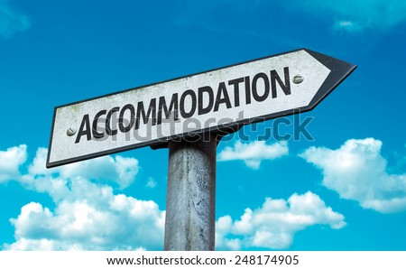 Accommodation sign with sky background - stock photo