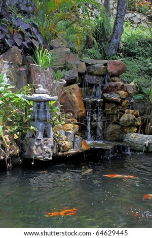 According to Chinese believes that koi ponds and water fountain could bring happines and joy in the property it is attached to. - stock photo