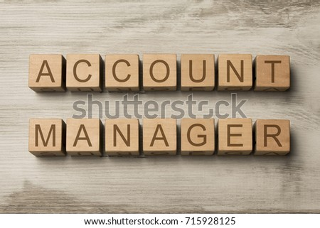 account manager text on wooden cubes on wooden background