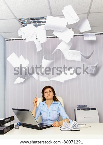 Accountant and falling paper - bad business documents - stock photo