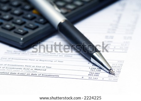 accountant calculating numbers with pen in macro
