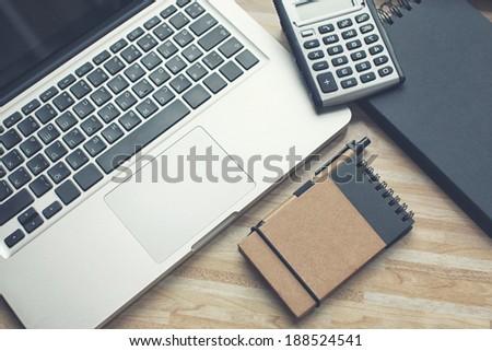Accountant desktop with a calculator - stock photo