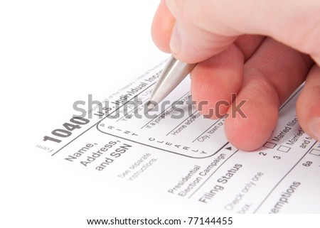 Accountant filling tax form by hand