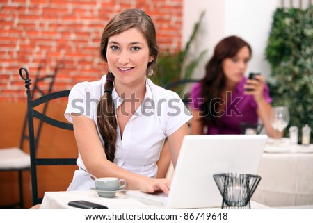 Accountant in restaurant - stock photo