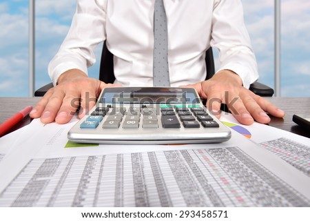 accountant man with financial report sitting in office