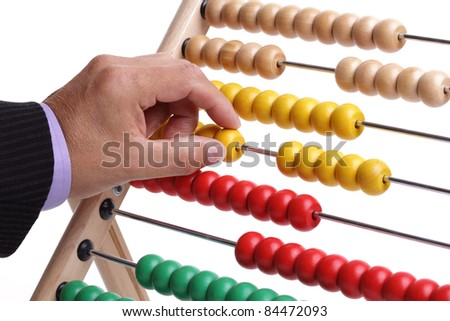 Accountant or businessman counting on an abacus concept for calculating finance - stock photo