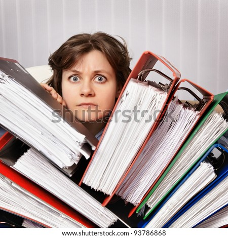 Accountant swamped the financial statements for the year - stock photo