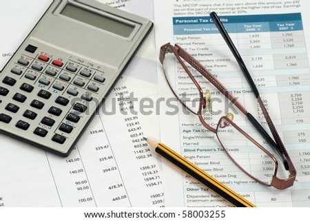 accountant  work space. statement,calculations and expenses - stock photo