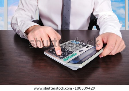 accountant working with calculator in the office - stock photo