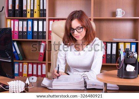 accountant works in the office with documents - stock photo