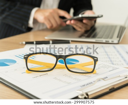 Accountants are preparing a report to present to the executive.