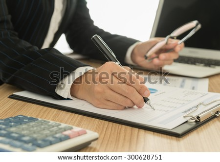 Accountants are preparing a report to present to the executive. - stock photo