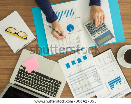 Accountants are working to analyze company data. top view - stock photo