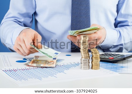 Accountants calculating profit - closeup shot of hands counting money - stock photo