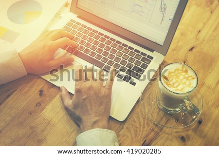 Accounting and technology in office.Business people using laptop at office,Analyze plans business graph and chart .Blog Blogging Homepage Social Media Network Concept.selective focus,vintage color 