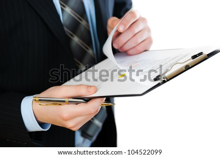 Accounting.Business records in the men's hands - stock photo