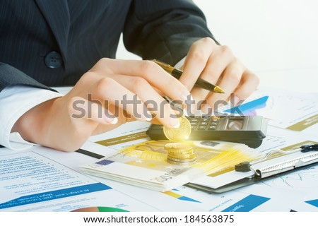 Accounting. Business woman hands in office. Money, coin - stock photo