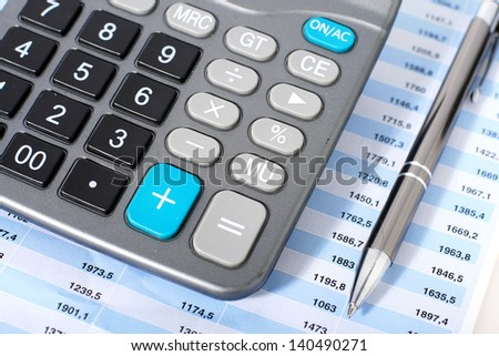 Accounting concept. Calculator and pen. - stock photo