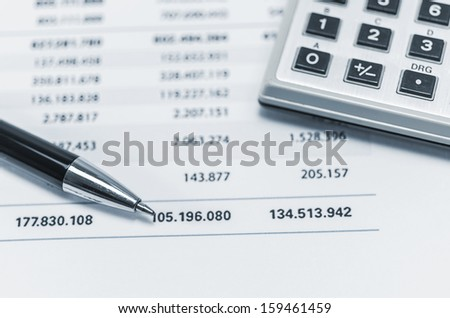 Accounting document with a calculator and pen - stock photo