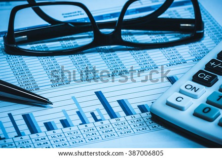 Accounting financial bank banking account stock spreadsheet data for accountant  with glasses pen and calculator in blue