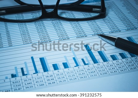 Accounting financial bank banking account stock spreadsheet data with glasses in blue for accountant