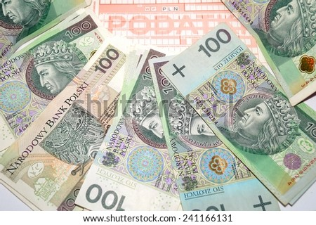 Accounting for taxes in poland - Polish money and form - stock photo