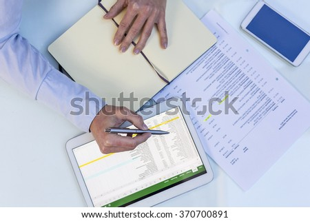 Accounting on a tablet computer, close-up - stock photo