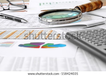 Accounting Tools, financial data and charts  on the Table  - stock photo