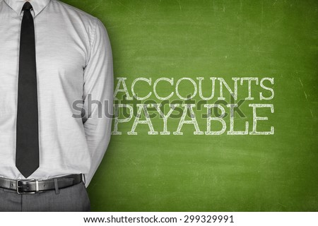 Accounts payable text on blackboard with businessman on side - stock photo