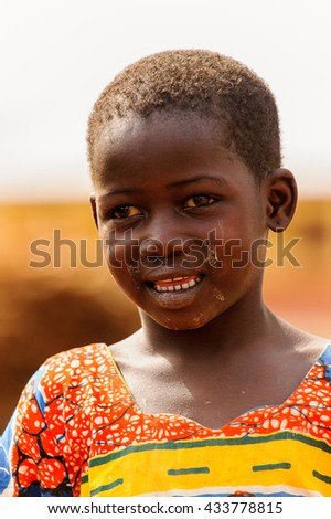 ACCRA, GHANA - MARCH 6, 2012: Unidentified Ghanaian boy smiles in the street in Ghana. Children of Ghana suffer of poverty due to the unstable economic situation