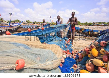 ACCRA, GHANA - MARCH 18: Unidentified Ghanaian fishermen doing their job at Teshie beach on March 18, 2014 in Teshie community, Accra, Ghana. Teshie is the famous fishing community in Ghana.