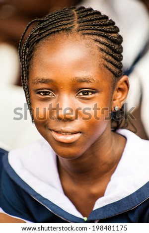 ACCRA, GHANA - MARCH 4, 2012: Unidentified Ghanaian girl in a school uniform in Ghana. School uniform is a part of the humanitarian help to Africa from the others countries