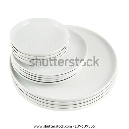 Accurate pile stack of the round ceramic white copyspace dish plates isolated over white background, above view - stock photo