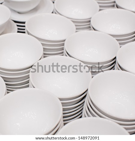 Accurate pile stack of the round ceramic white empty copyspace dish plates - stock photo