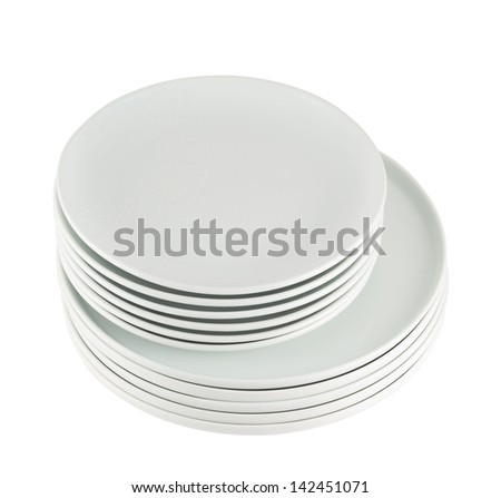 Accurate pile stack of the round ceramic white empty copyspace dish plates isolated over white background, view above