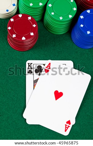 Ace and king playing cards with poker chips - stock photo