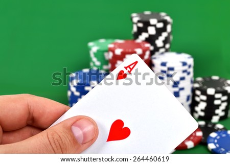 Ace, jack in hand and poker chips stack - stock photo