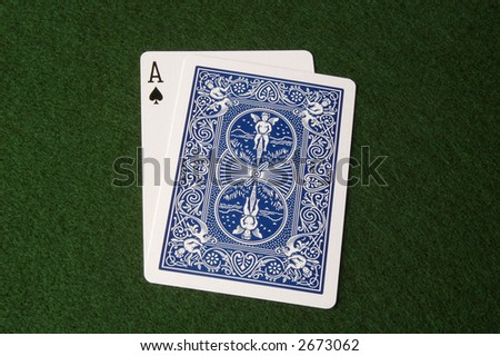 Ace showing, cards covering; might be blackjack - stock photo