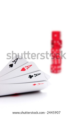 Aces high with out of focus stack of poker dice in the background - shallow dof on white - stock photo