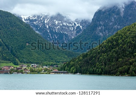 Achensee ( Lake Achen) summer landscape with cloudy sky and snow on mount top (Austria).
