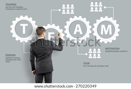 Achieve. Business man with team building concept - stock photo