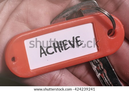 ACHIEVE word written on key chain