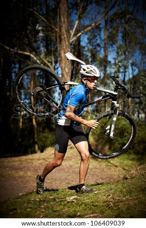 Achievement / Effort concept: Successful young man running a race with a bike - stock photo