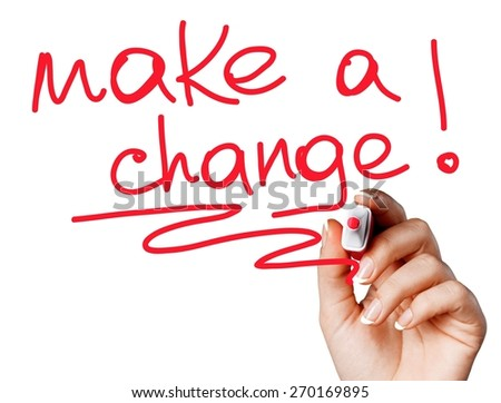 Achievement. Hand writing Make a Change with red marker on transparent wipe board. - stock photo