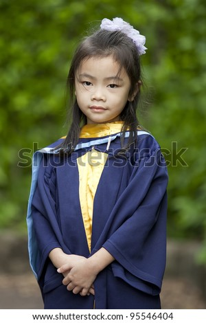 Achievement of degree for young babay in the green nature. - stock photo