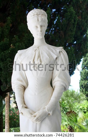 Achilleon, Corfu island, Greece - June 22nd, 2010 - Sculpture of Austrian emperes Elisabeth (Sissi) in front of Achillion (her summer residence). - stock photo