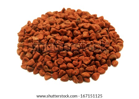 Achiote seeds on a white background - stock photo