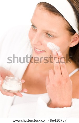 Acne facial care teenager woman apply cream foam on white